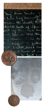 Slates from Evans' collection. The first is black with chalk writing. The second is light gray with images of ghosts impressed into it.