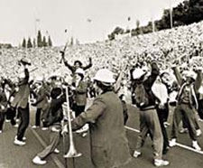 The Stanford Band plays close to the crowd, gathered without any clear organization, playing wildly.