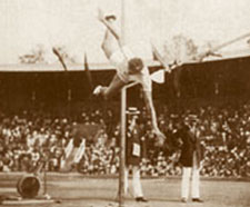 George Horine attempts the high-jump in front of a crowd.