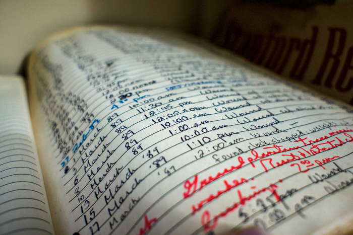 Photo of slightly yellowed log page, including handwritten entries.