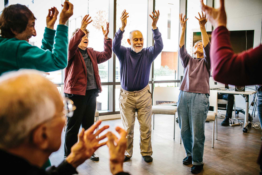 A group of older individuals practicing dance moves