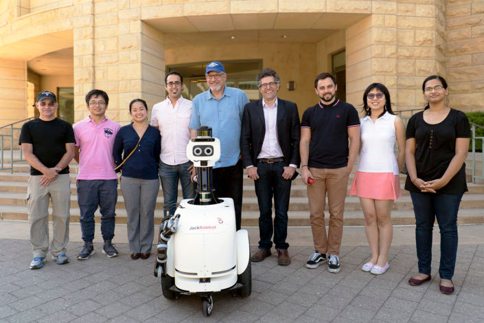 Photo of JackRabbot2 and team on campus.
