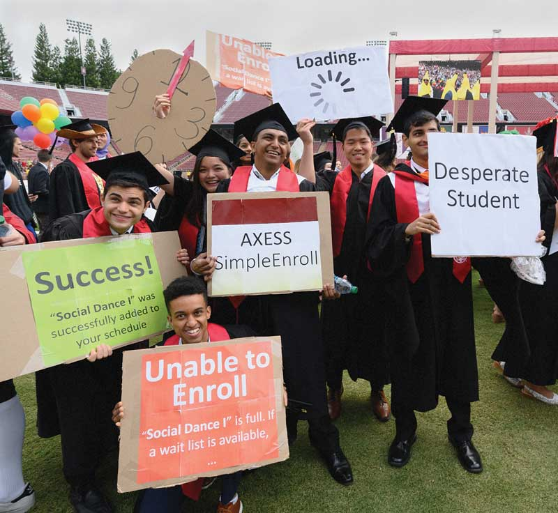 Photo of graduates during Wacky Walk holding signs.