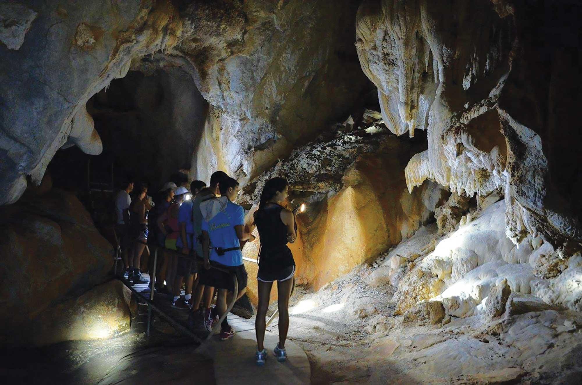 Students exploring a cave