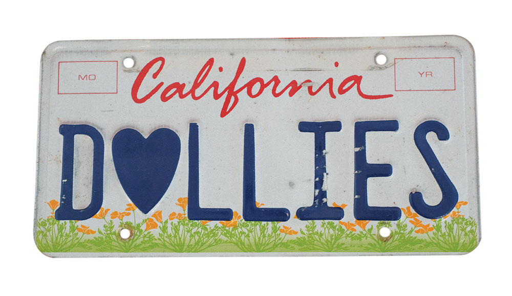 Silhouette of California license plate with the phrase DOLLIES