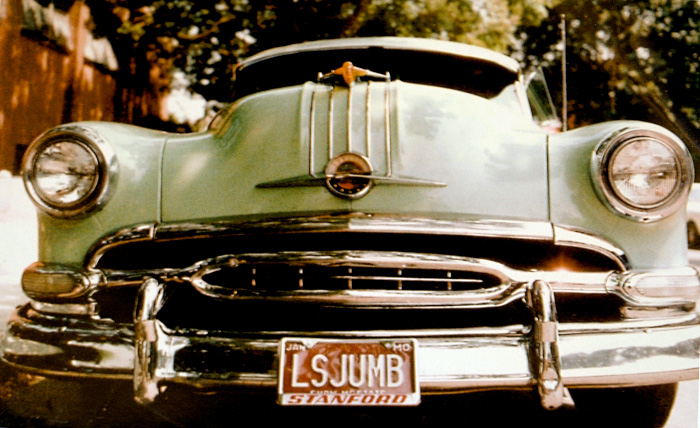 Silhouette of California license plate with the phrase LSJUMB