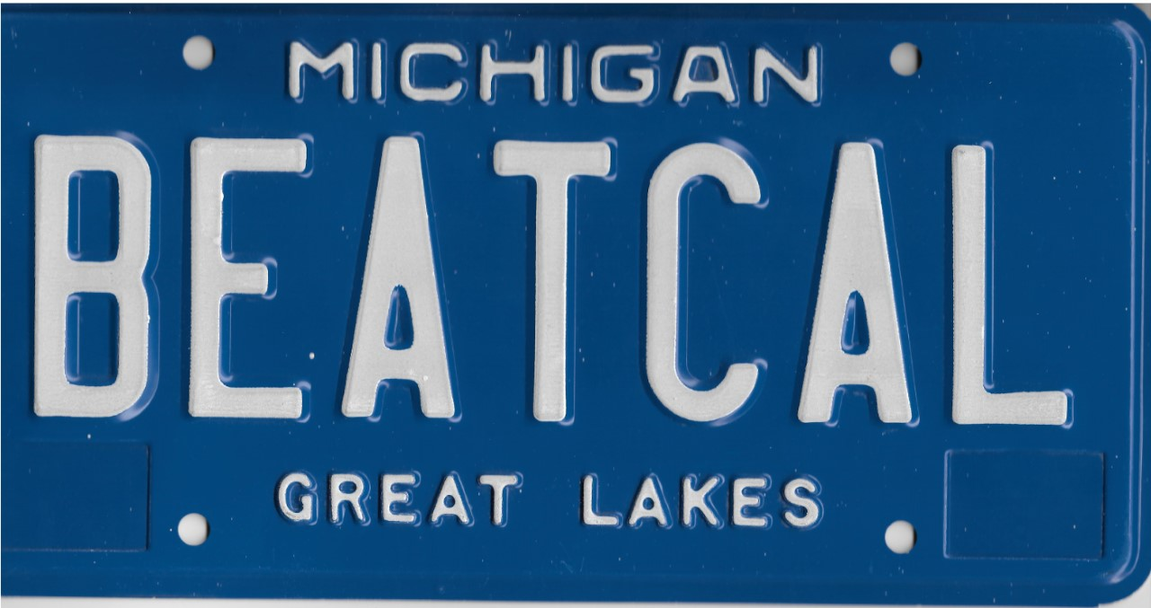 Silhouette of Michigan license plate with the phrase BEATCAL