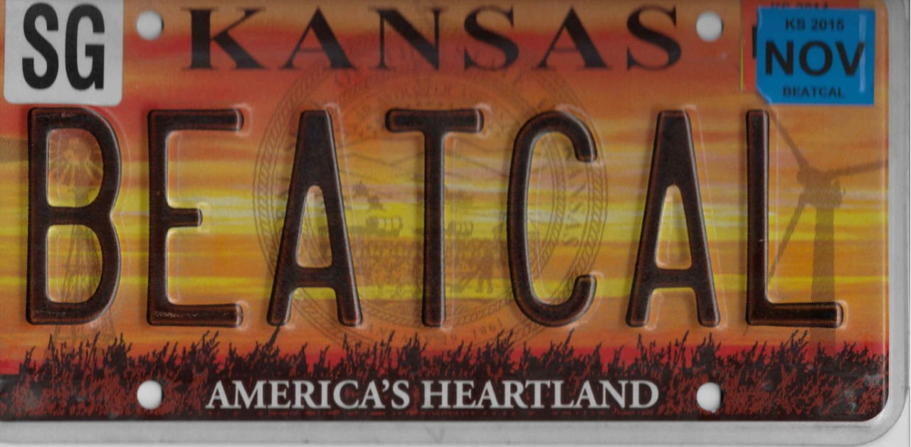 Silhouette of Kansas license plate with the phrase BEATCAL