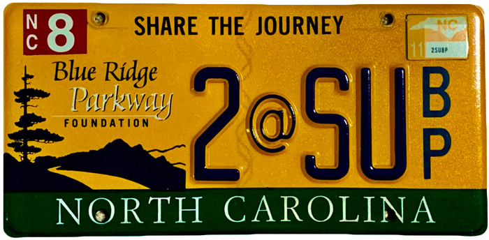 Silhouette of North Carolina license plate with the phrase 2@SU