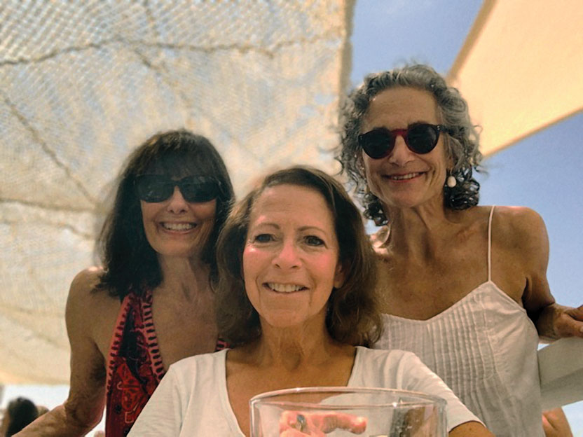 Group photo of Melinda Sacks, '74, Gail Block Harris, '74, JD '77, and Barbara Lane, '74.