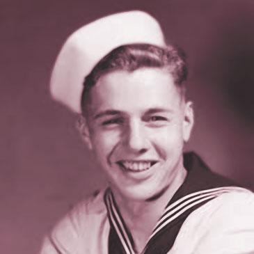 Portrait of Len Gardner smiling in his Navy uniform.
