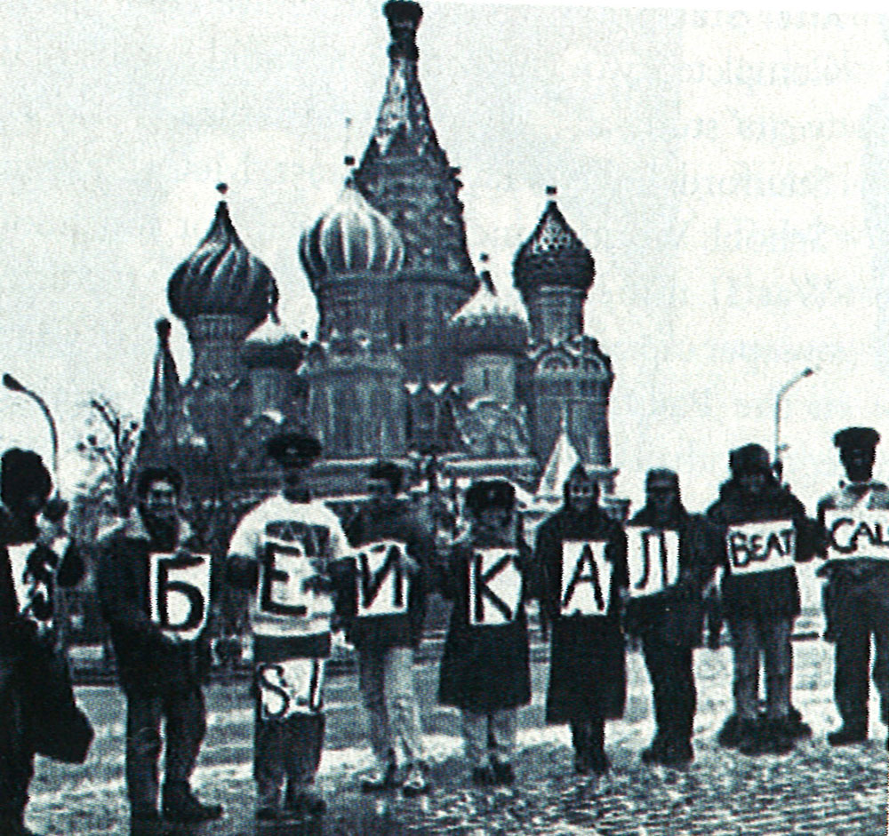 "Individuals holding up signs that say, ""Beat Cal,"" in Moscow's Red Square"