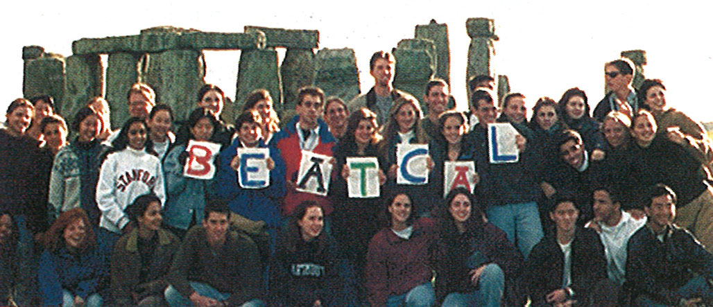 Group of men and women holding up signs that spell Beat Cal at Stonehenge