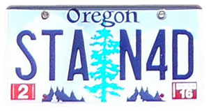 Silhouette of Oregon license plate with the phrase STAN4D
