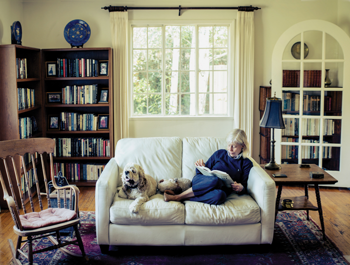 Deborah Rhode on couch with her dog