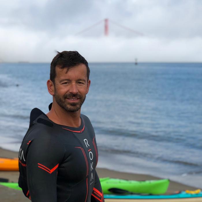 Alex Kostich wearing a wetsuit.