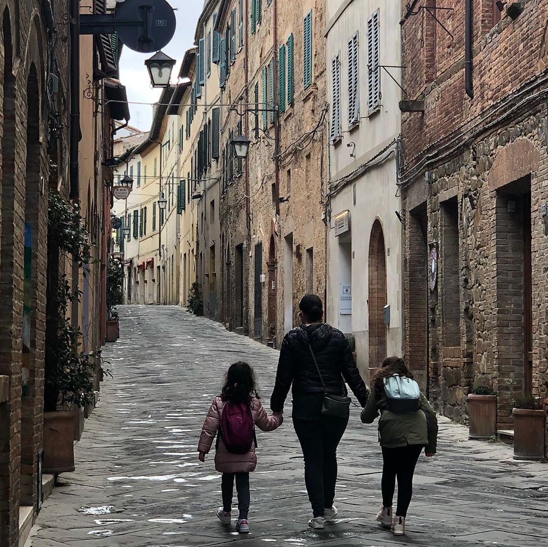 Family walking down streets of Milan