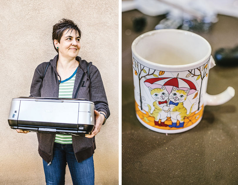 Left, photo of a woman holding a printer; right, a mug with a broken handle featuring an illustration of two cats holding an umbrella
