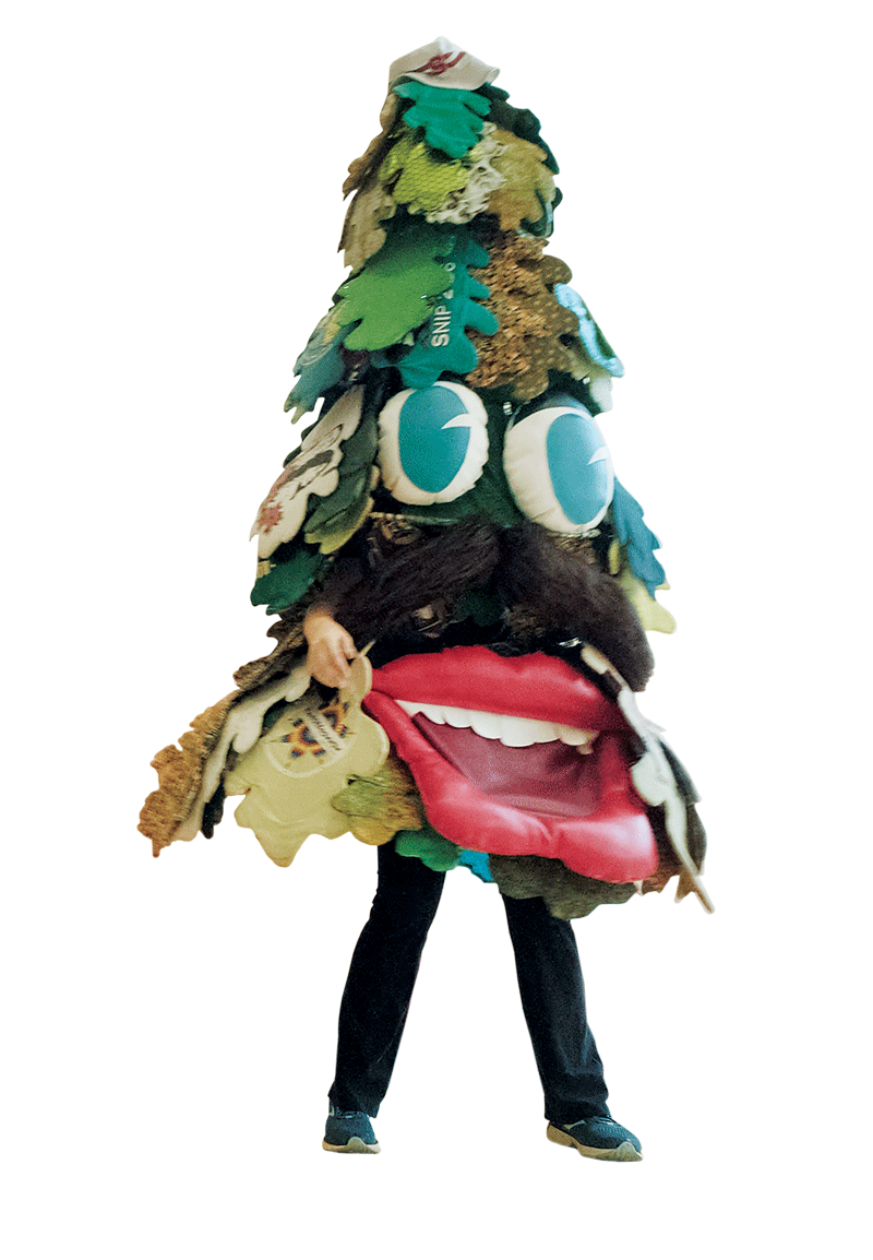 Silhouette of Summer Batte dressed in a tree mascot costume.