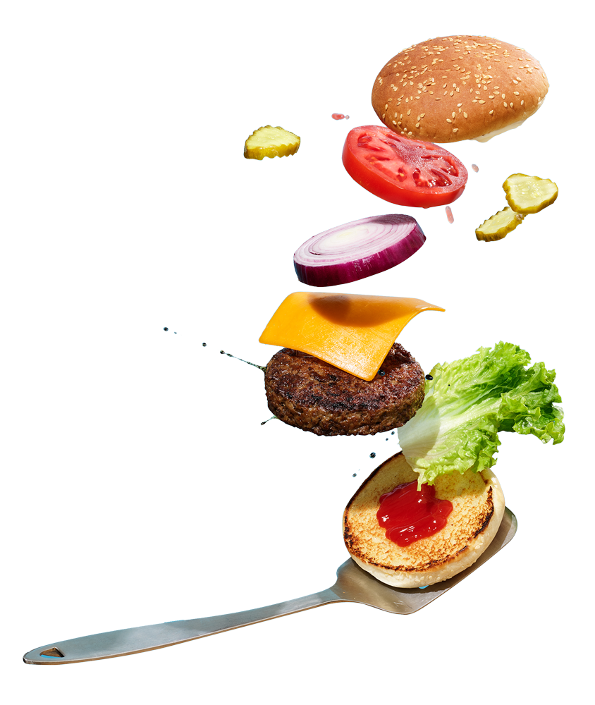 A deconstructed photograph of a hamburger being flipped by a spatula.