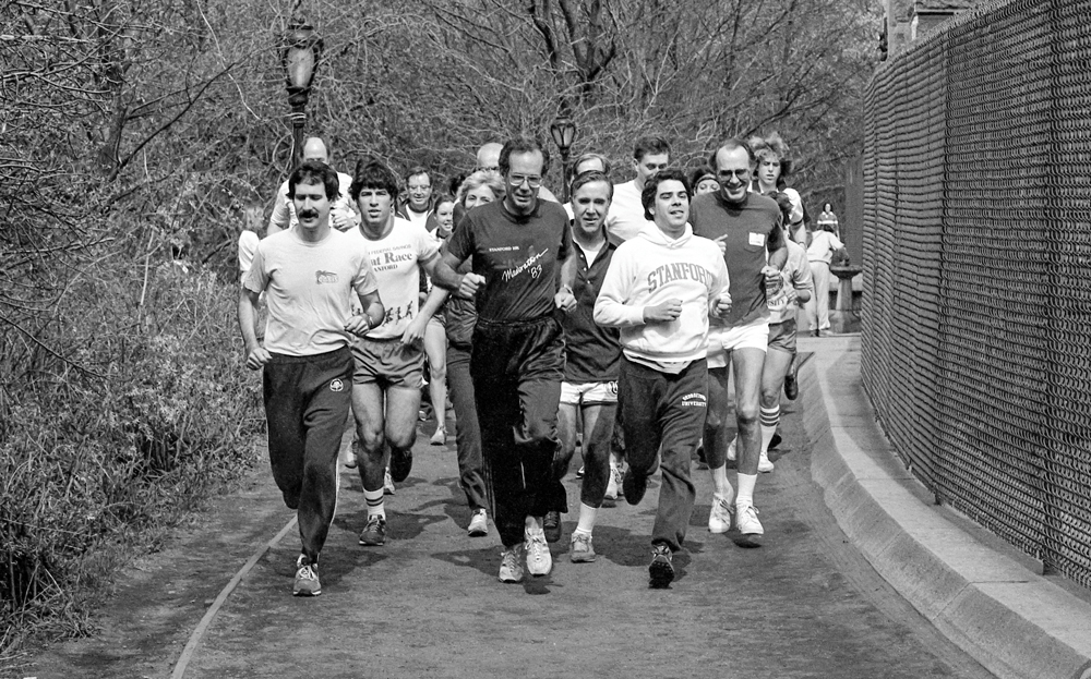 Kennedy running with a group of people