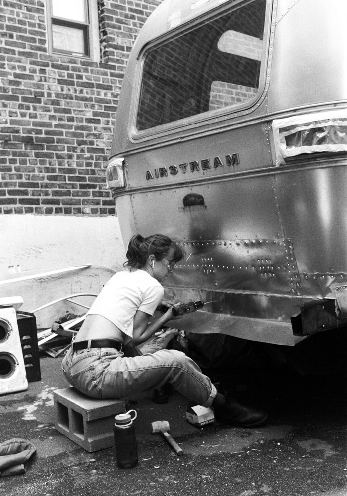 Doyle adds a storage compartment to the Free Film: USA Airstream trailer outside Worthless Studios in Manhattan.