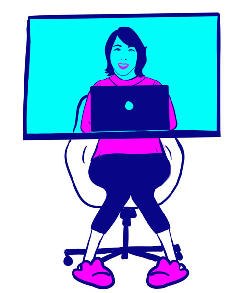 Woman sitting in front of computer on a Zoom call in slippers.