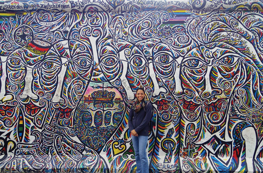 Amber Moore in front of colorful wall in Berlin