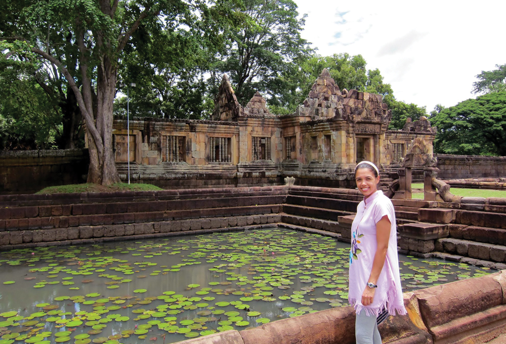 Amber Moore in front of a pond in Thailand