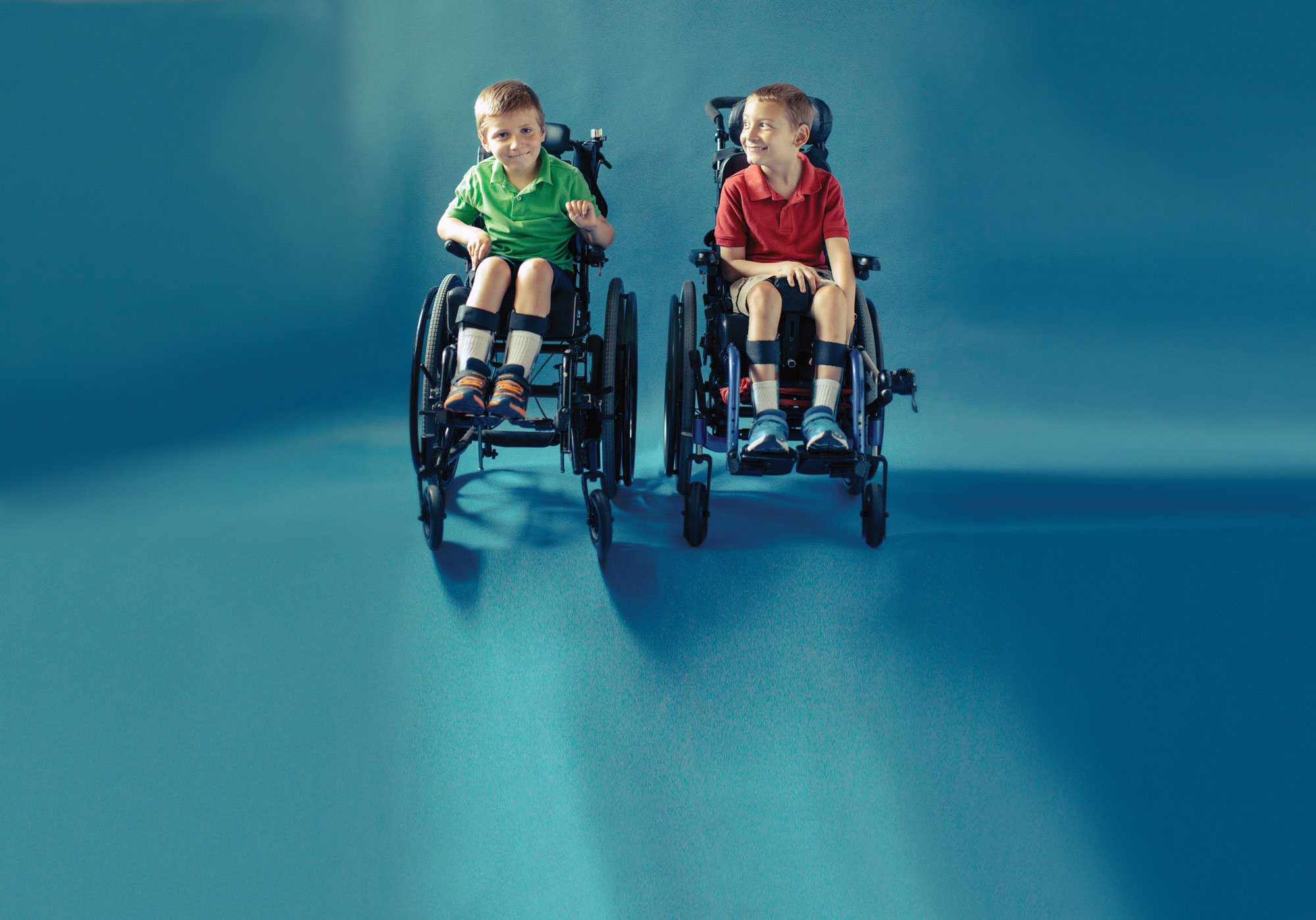 Two young brothers in wheelchairs