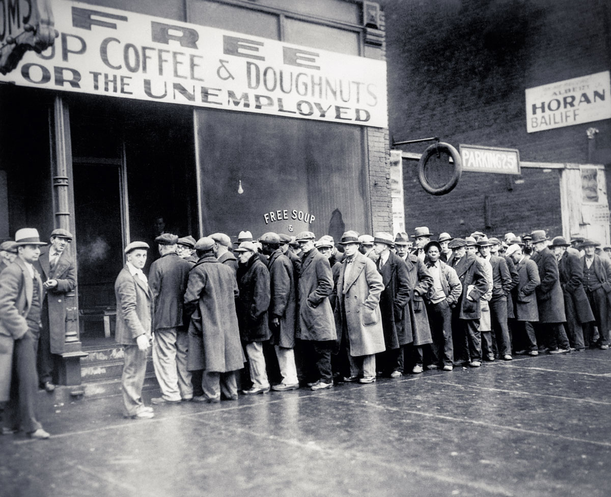 Unemployed men queued outside a depression-era soup kitchen opened in Chicago by Al Capone. Photo taken February 1931.