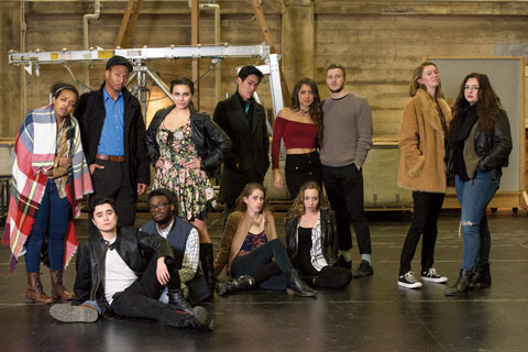 The cast of Rent. They are a diverse crew wearing all sorts of thrifty streetwear.