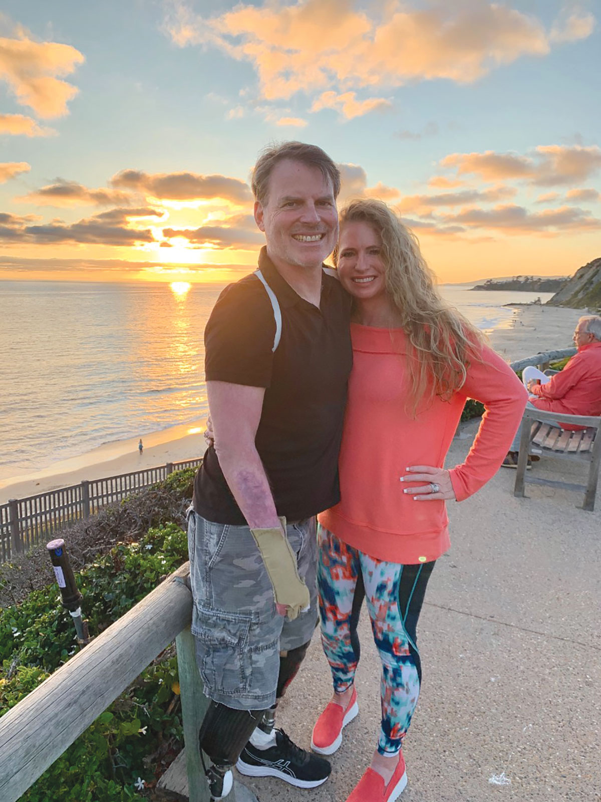 Marty Hartigan standing outside with his wife at sunset