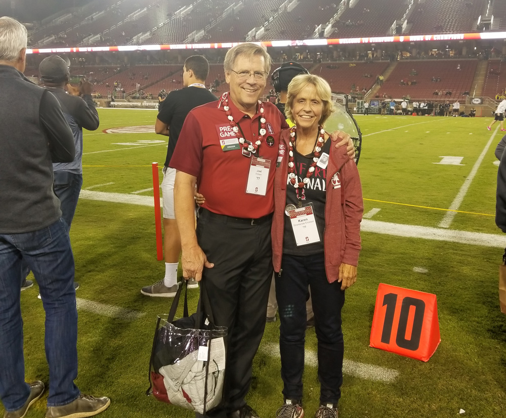 Joel and Karen Erickson on the field at a Stanford football game.