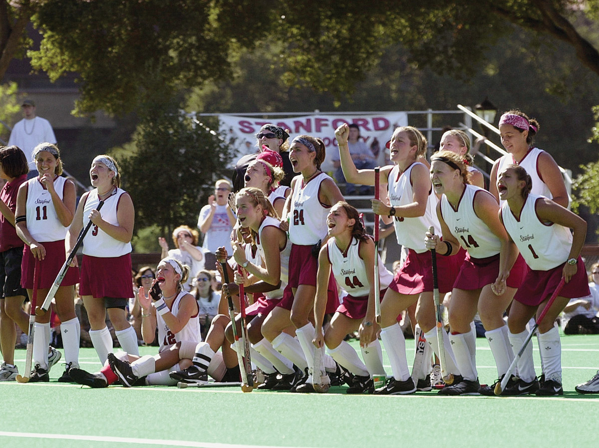 A group of players playing Field Hockey