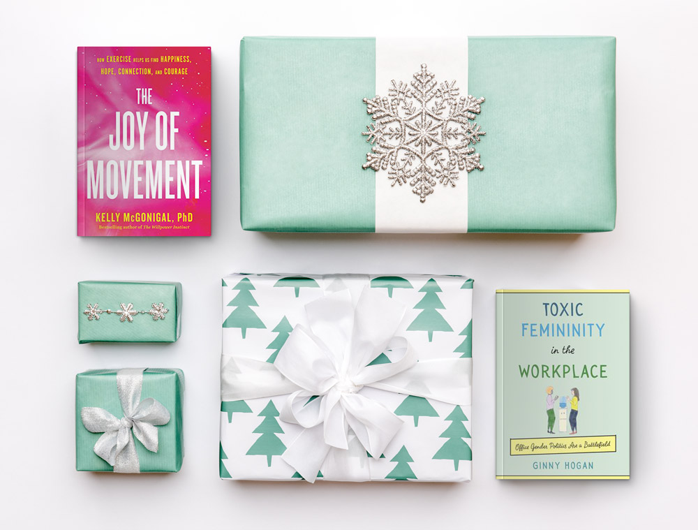 Two books and three presents on a white backdrop