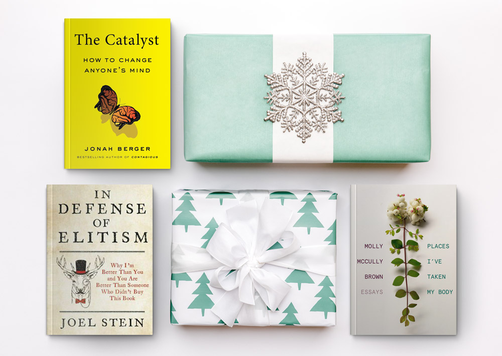 Three books and two presents on a white background