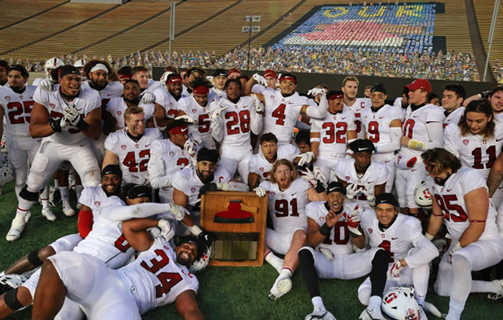Stanford football team surrounding the Axe
