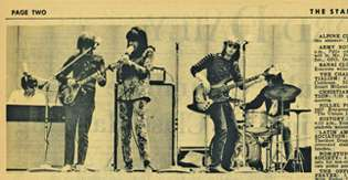 A newspaper cutout containing a photo of Jefferson Airplane playing live.