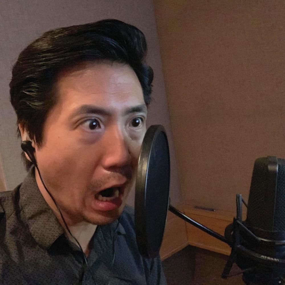 Greg Chun yelling into the mic.