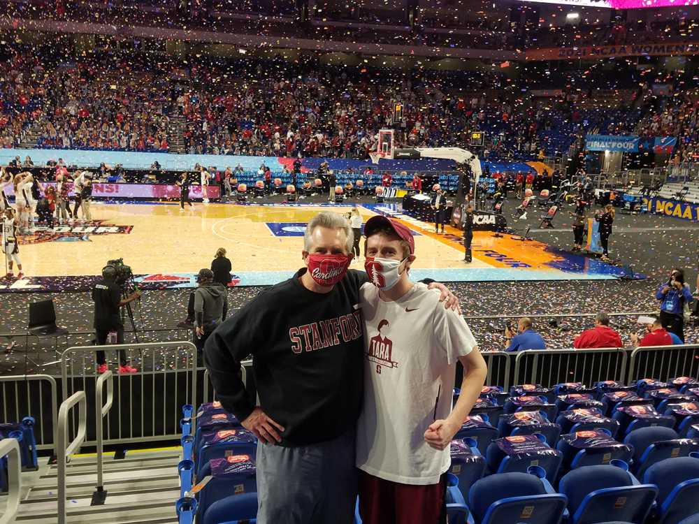 Steve Easton and Nathaniel in the stands wearing masks