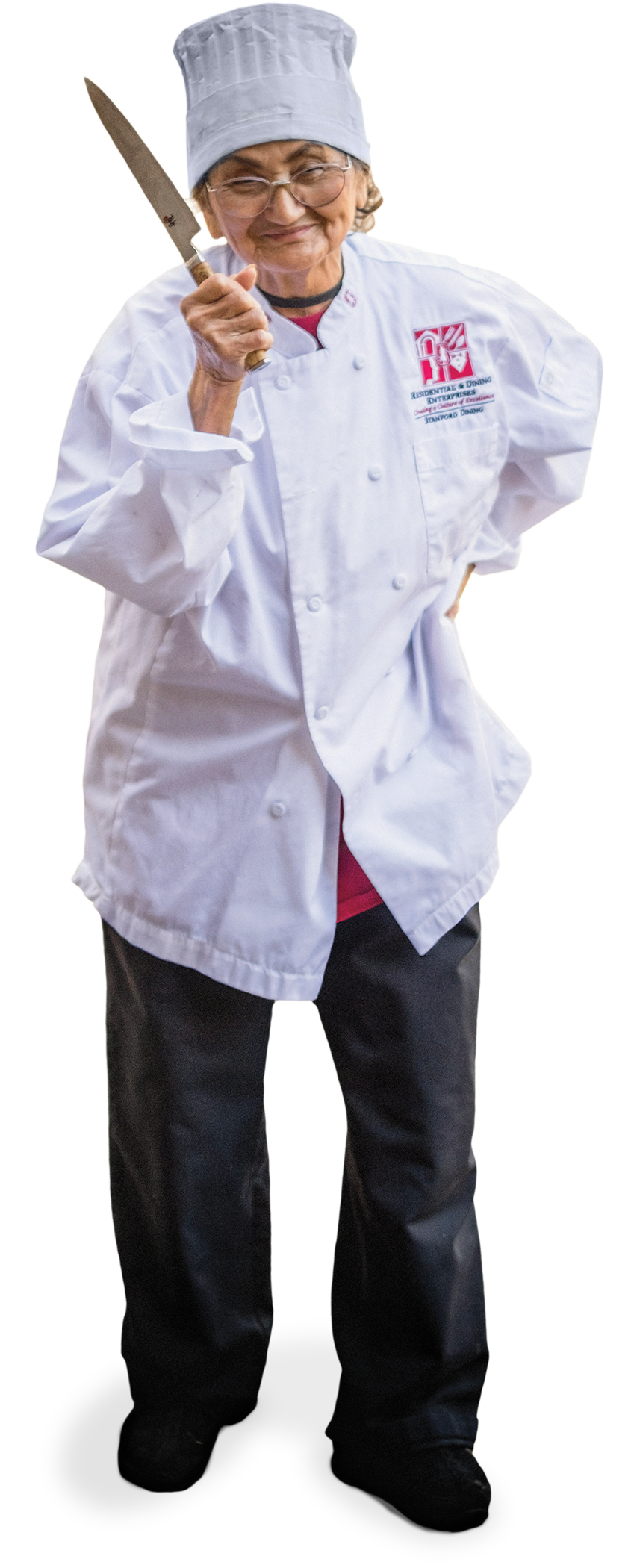 Ana Ziadeh wearing a chef outfit and holding a knife