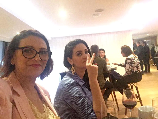 Photo of Luciana Frazao and her mother at an event.