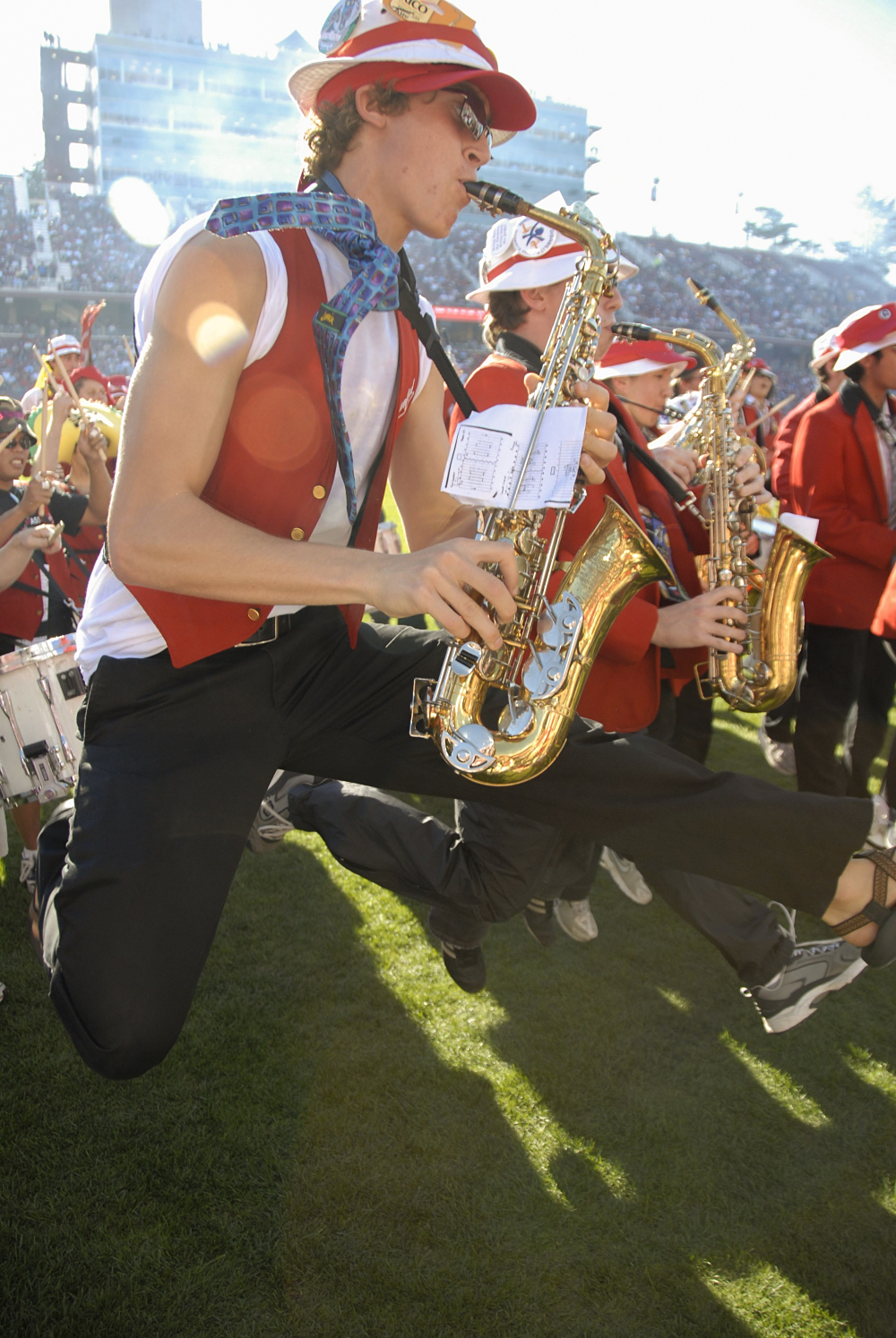 Sax players jumping with their horns