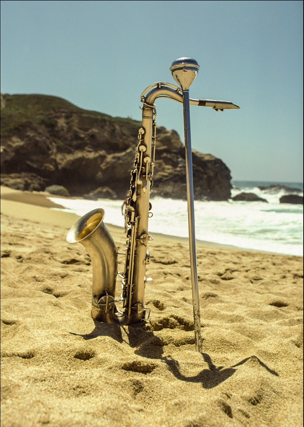 Saxaphone standing up in the sand