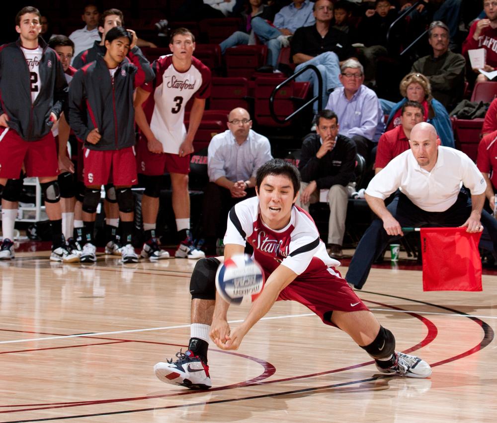 Erik Shoji digging for the volleyball