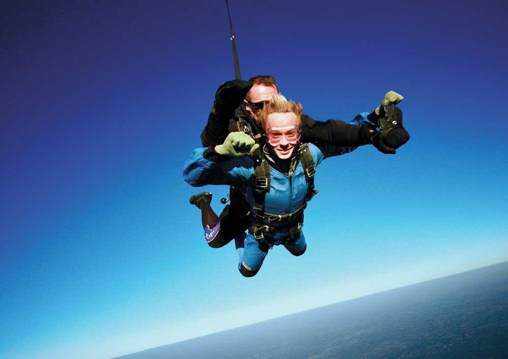 Nick Hakes skydiving in midair.