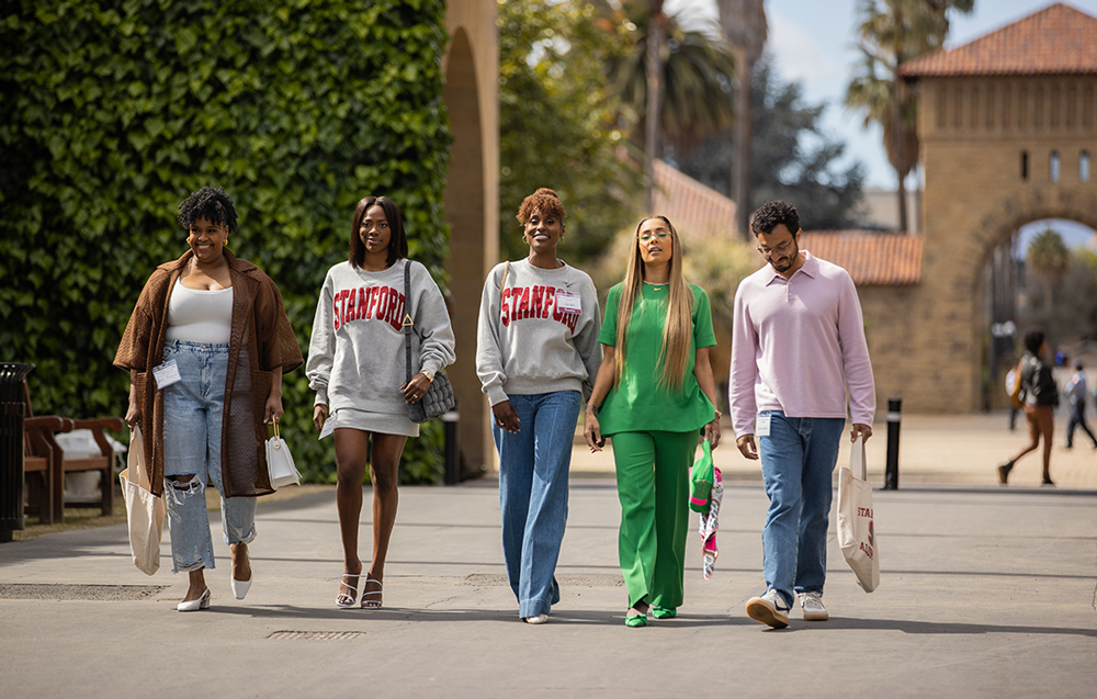 Issa Rae and other castmates walking through the Quad